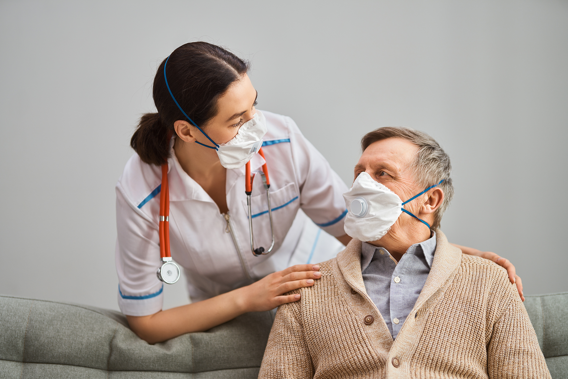 Caregiver talks to elderly patient during COVID-19 | Featured image for INFECTION CONTROL TRAINING ACT - SKILL SETS.
