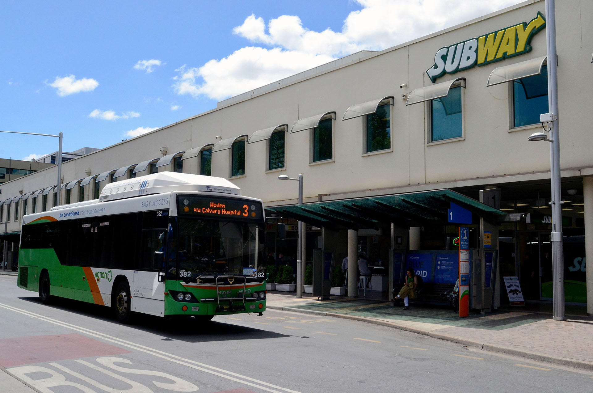 Bus outside commercial shops | Featured image for HLTSS ICTL67 FOR TRANSPORT AND LOGISTICS.