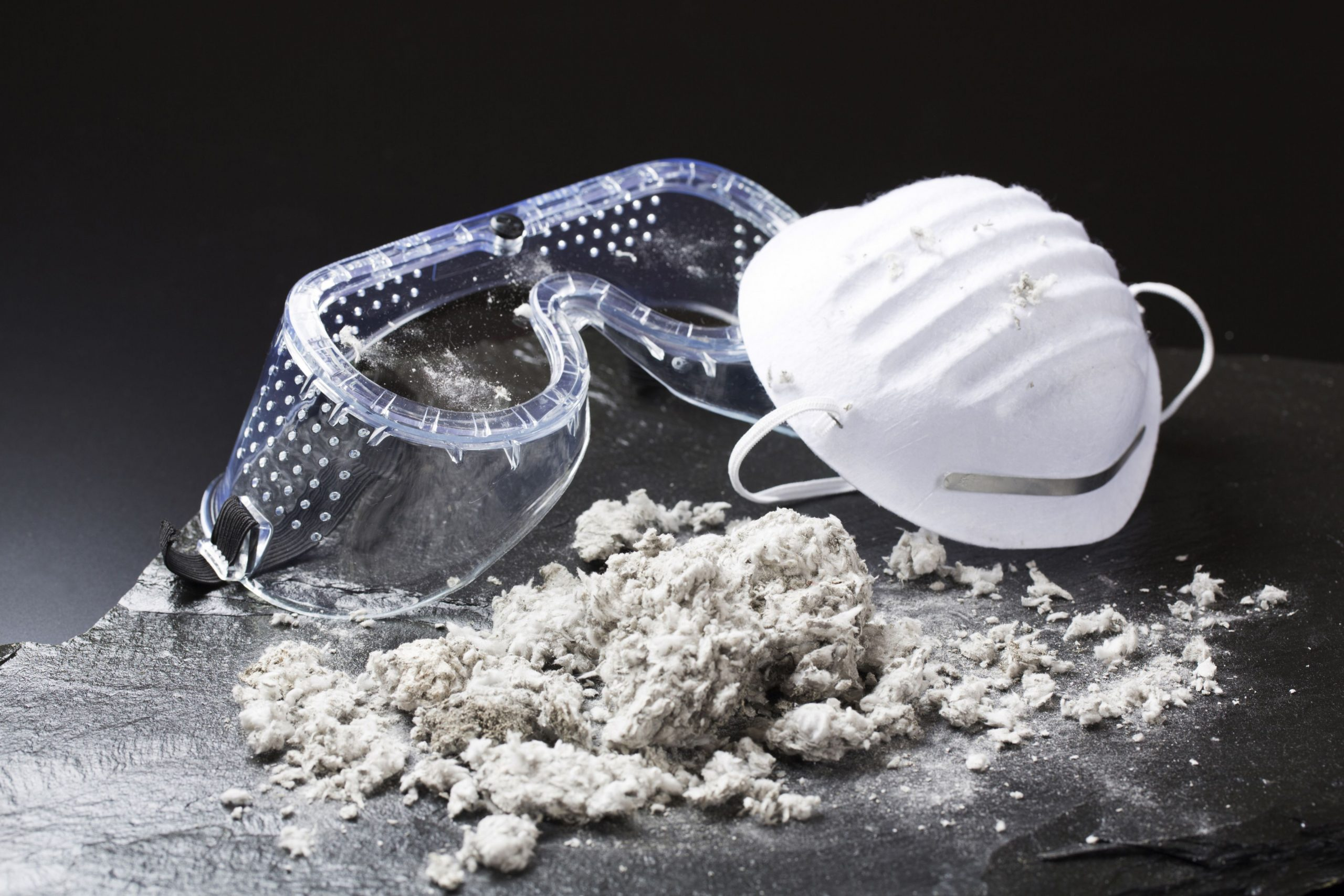 Image of protective glasses and dust mask for asbestos awareness short construction courses.