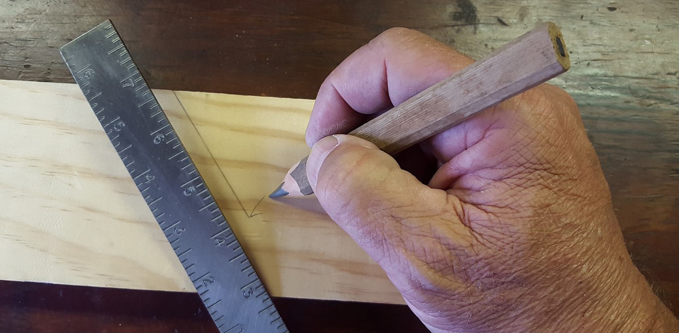 Image of carpenter using carpenters pencil | Featured image for Courses in Building and Construction.