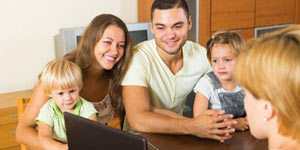 Family looking at laptop | Healthcare Courses