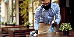 Man cleaning table | Infection prevention and control training