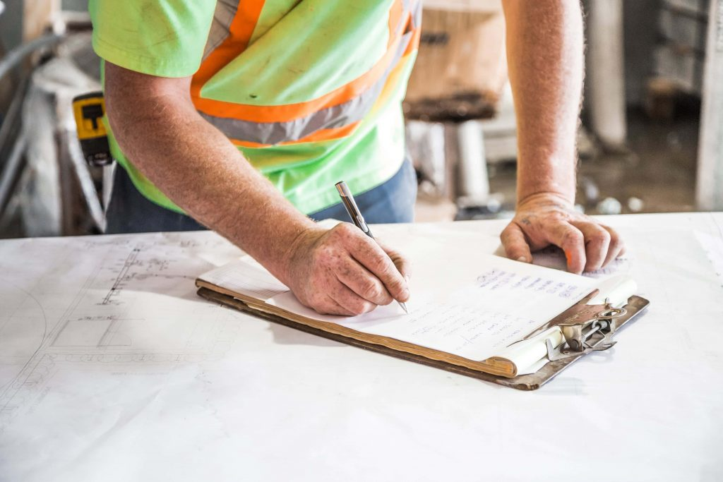 A construction worker fills out a form