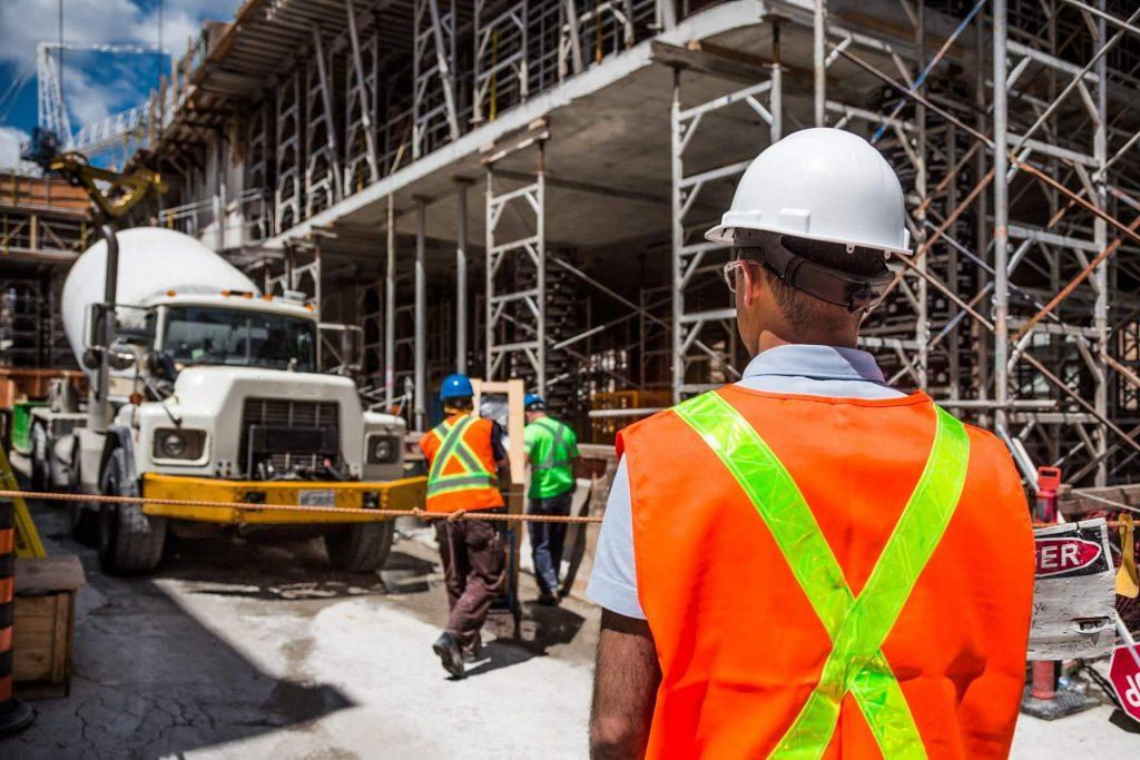 A construction worker surveys the site