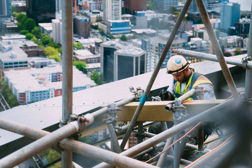a construction worker at work in a high rise